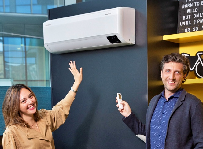 This photo provided by Samsung Electronics Co. on Aug. 2, 2021, shows the company's employees introducing Samsung's wind-free air conditioner at its showroom in Italy.