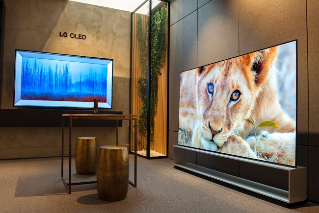 This photo provided by LG Electronics Inc. on June 25, 2021, shows the company's OLED TVs displayed at a shop in Paris.