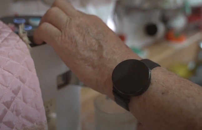 This photo provided by Yongin City Office shows a wearable band for elderly care service.