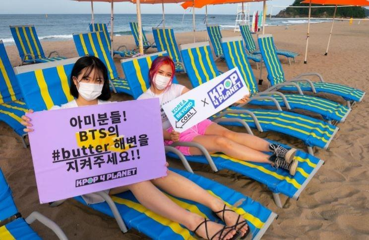 Activists hold signs pleading fans to participate in the movement to help save Maengbang Beach in Samcheok, Gangwon Province, in this undated photo provided by Korea Beyond Coal.