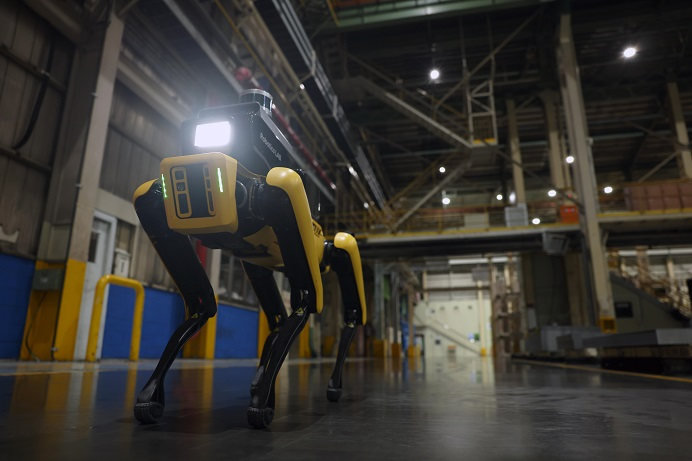 A factory safety service robot, which is based on U.S. robot startup Boston Dynamics' four-legged Spot, inspects the safety of Kia Corp.'s automotive factory in Gwangmyeong, southwest of Seoul, in this photo provided by Hyundai Motor Group on Sept. 17, 2021.