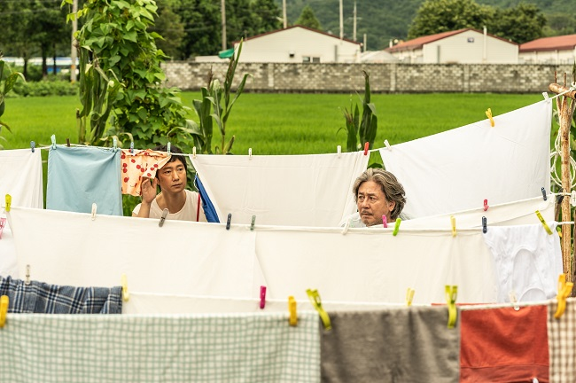 """This image provided by the Busan International Film Festival shows a scene from """"Heaven: To the Land of Happiness."""""""