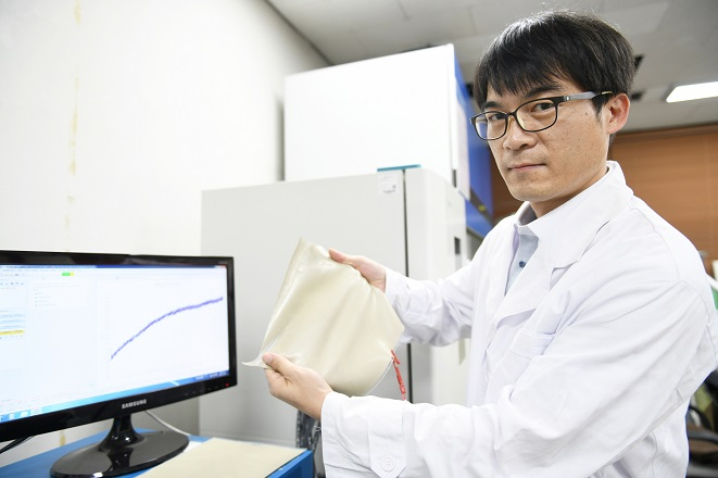This photo provided by the Korea Electrotechnology Research Institute shows the institute's researcher working at its newly-developed device.